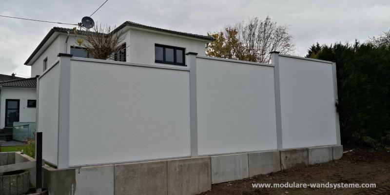 Modulare-Wandsysteme-Sichtschutz-Larmschutz-hinter-L-Steine-gesetzt